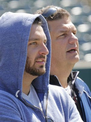 Jake Golic and his father Mike watch UC's spring game in April, when Jake was in the process of returning to the Bearcats.