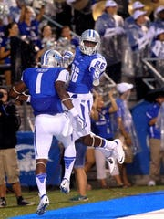 MTSU's Shane Tucker (1) and Devin Clarke (86) celebrate after a play in Saturday's win.