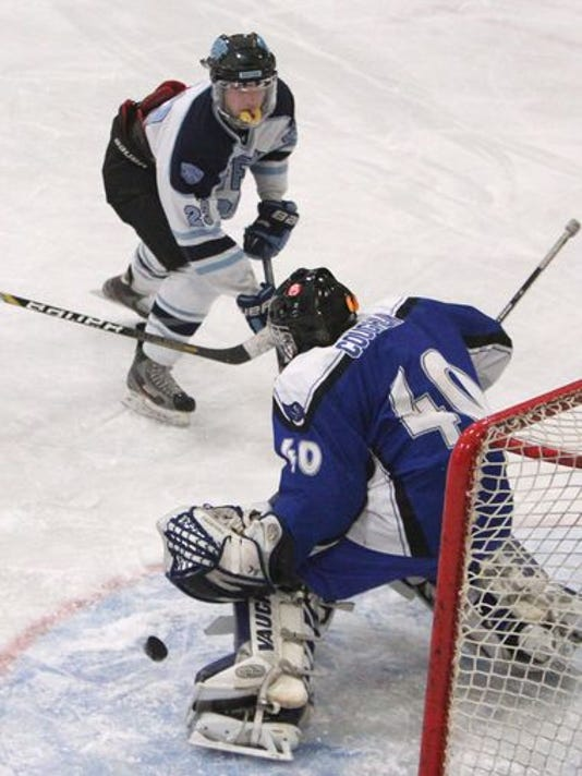 Suffern's C.J. Greco shoots on Pearl River goalie Sam Coughlin during their game at Sport-O-Rama Jan. 30, 2015. (Photo: , Peter Carr/The Journal News)