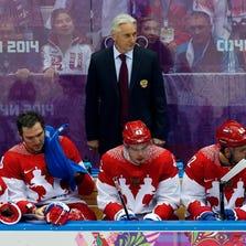 Feb 15, 2014; Sochi, RUSSIA; Russia head coach Zinetula Bilyaletdinov in a men's preliminary round ice hockey game during the Sochi 2014 Olympic Winter Games at Bolshoy Ice Dome. Mandatory Credit: Winslow Townson-USA TODAY Sports
