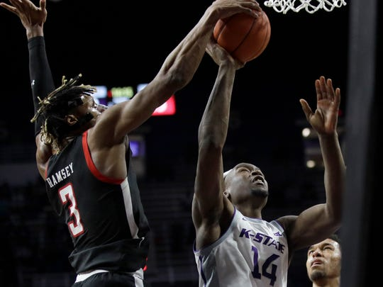 Texas Tech guard Jahmi'us Ramsey (3) blocks a shot by Kansas State forward Makol Mawien (14) during the second half of an NCAA college basketball game in Manhattan, Kan., Tuesday, Jan. 14, 2020. (AP Photo/Orlin Wagner)