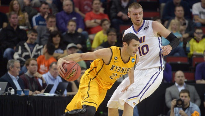 Wyoming forward Larry Nance Jr. (22) moves the ball against Northern Iowa forward Seth Tuttle (10) during the second half Friday. Tuttle and the Panthers have held 26 opponents under 60 points this season.
