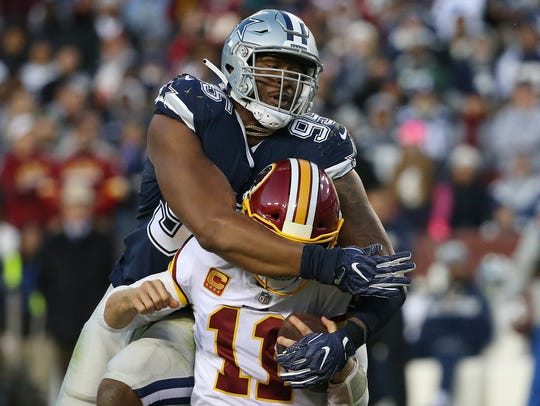 Dallas Cowboys defensive lineman David Irving tackles
