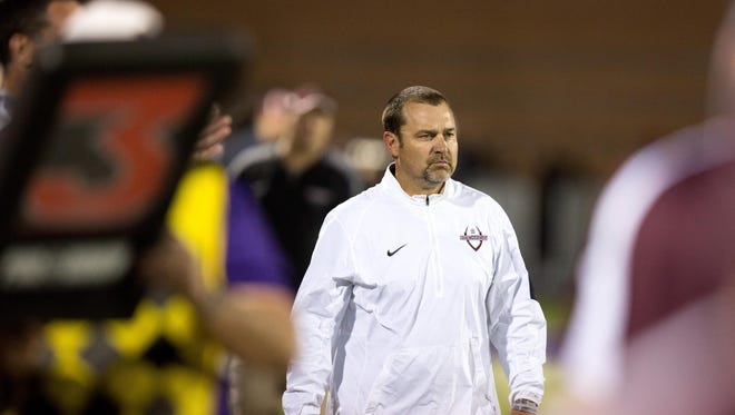 Dowling High School head coach Tom Wilson watches his team play Waukee in the second quarter Friday, Sept. 11, 2015, in Waukee.