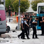 In this Tuesday, June 7, 2016 file photo, Turkish police work at the scene of an explosion in Istanbul.