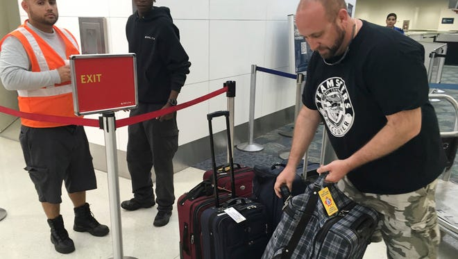 Dan Kovacs waits at the Fort Lauderdale-Hollywood International Airport, Saturday, Jan. 7, 2017. Kovacs and his family were going through security when gunfire erupted yesterday. They had returned from a Caribbean cruise and were on their way home to Vancouver, Canada. In the mayhem after the shooting they lost their shoes, passports and ID's. (AP Photo/Kelli Kennedy)