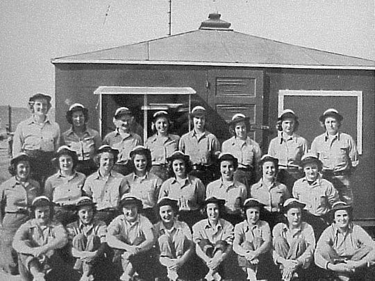 A group of WAVES, Women Accepted for Volunteer Emergency Service, aboard Whiting Field Naval Air Station.