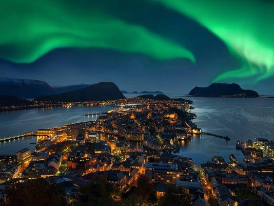 Northern lights - Green Aurora borealis over Alesund, Norway