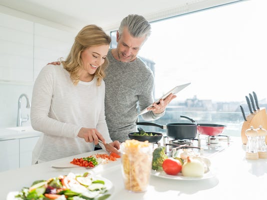 Couple cooking dinner together