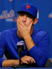 New York Mets pitcher Matt Harvey's 2013 season is cut short by injury. Harvey speaks during a news conference announcing that he has been diagnosed with a partially torn ligament on Aug. 26, 2013, in New York.