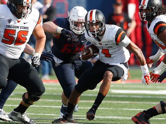 Oregon State quarterback Seth Collins (4) runs the football against Arizona during the second half of an NCAA college football game, Saturday, Oct. 10, 2015, in Tucson, Ariz. (AP Photo/Rick Scuteri)