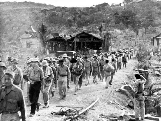 American and Filipino prisoners of war captured by the Japanese are shown at the start of the Death March after the surrender of Bataan on Apr. 9, 1942 near Mariveles in the Philippines, during World War II. Hundreds of American soldiers and thousands of Filipinos died along the way.