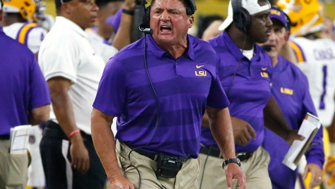 LSU coach Ed Orgeron reacts on the sideline as LSU plays Miami during the first half of an NCAA college football game Sunday, Sept. 2, 2018, in Arlington, Texas. (AP Photo/Ron Jenkins)