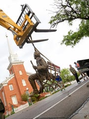 """City workers move """"George Washington,"""" a sculpture"""