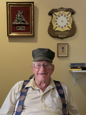 Dick Olson, a Korean War veteran, sits in his room Thursday at the Southern Utah Veterans Home in Ivins with memorabilia from his service and civilian career, including his father's Purple Heart.