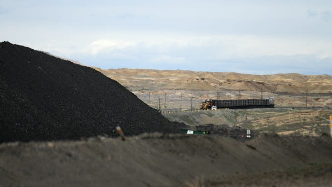 A train waits to pick up a load of coal, Wednesday, April 26, 2017 at the area of the Navajo Mine in Nenahnezad..