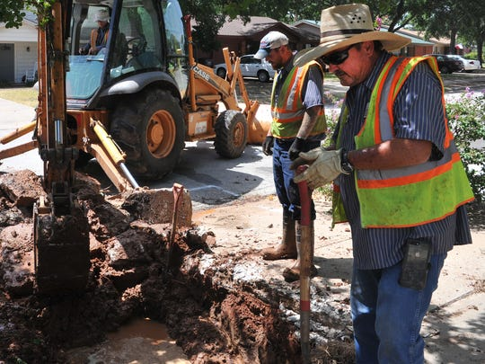 In this file photo, water-distribution crews work on a water-main repair. The city will or doing a scheduled water-main repair at Fairway and Southwest Parkway.