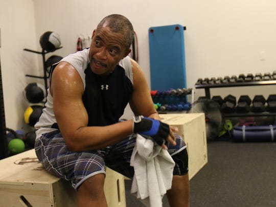 Dewayne Mills rests on a plyometric box while training at Xcelerate Fitness Friday in Newport.
