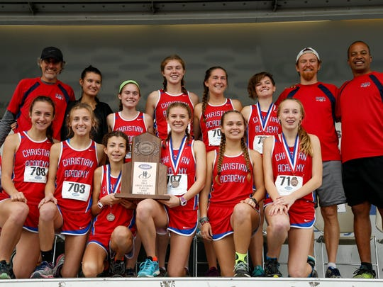 The Christian Academy girls cross country team poses