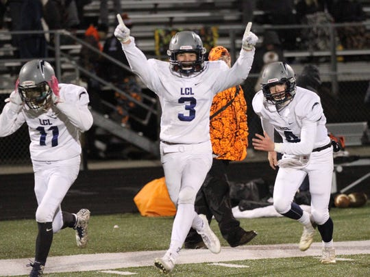 Lake Country Lutheran players (from left) Zander Mueller, Bryce Haertle and Ethan Wilkins celebrate their team's trip to the Division 5 state championship game Nov. 10.