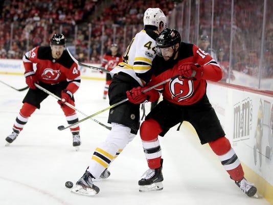 636469832738299382-Bruins-Devils-Hockey-njha.jpg