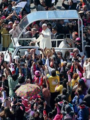 Pope Francis rides in his popemobile Feb. 13, 2016,