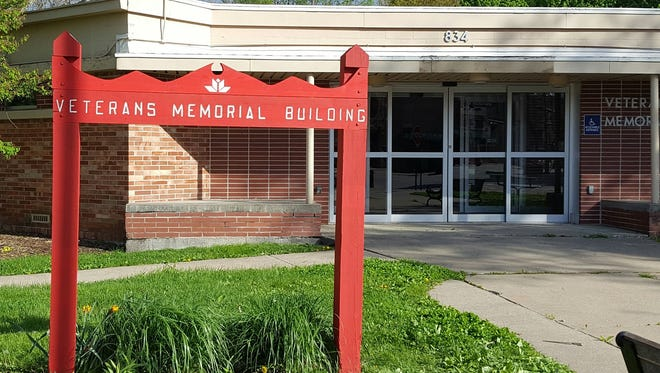 The city of Grinnell changed the locks on the Veteran's Memorial Building following a volunteer work day by area veterans and has locked the doors. The two sides are expected to meet to discuss the future of the building.