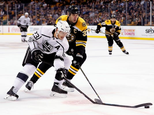 Los Angeles Kings right wing Dustin Brown (23) has his stick broken by Boston Bruins defenseman Zdeno Chara who received a slashing penalty on the play during the first period of an NHL hockey game in Boston, Saturday, Oct. 28, 2017. (AP Photo/Winslow Townson)