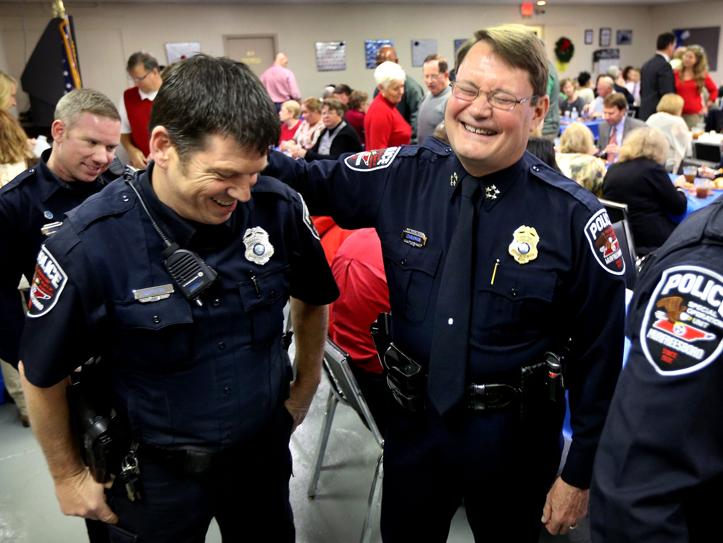 Murfreesboro Police Officer Patrick Doughtie, left,