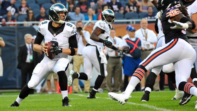 Philadelphia Eagles quarterback Nick Foles (9) passes against the Chicago Bears in the first quarter during a preseason game at Soldier Field.