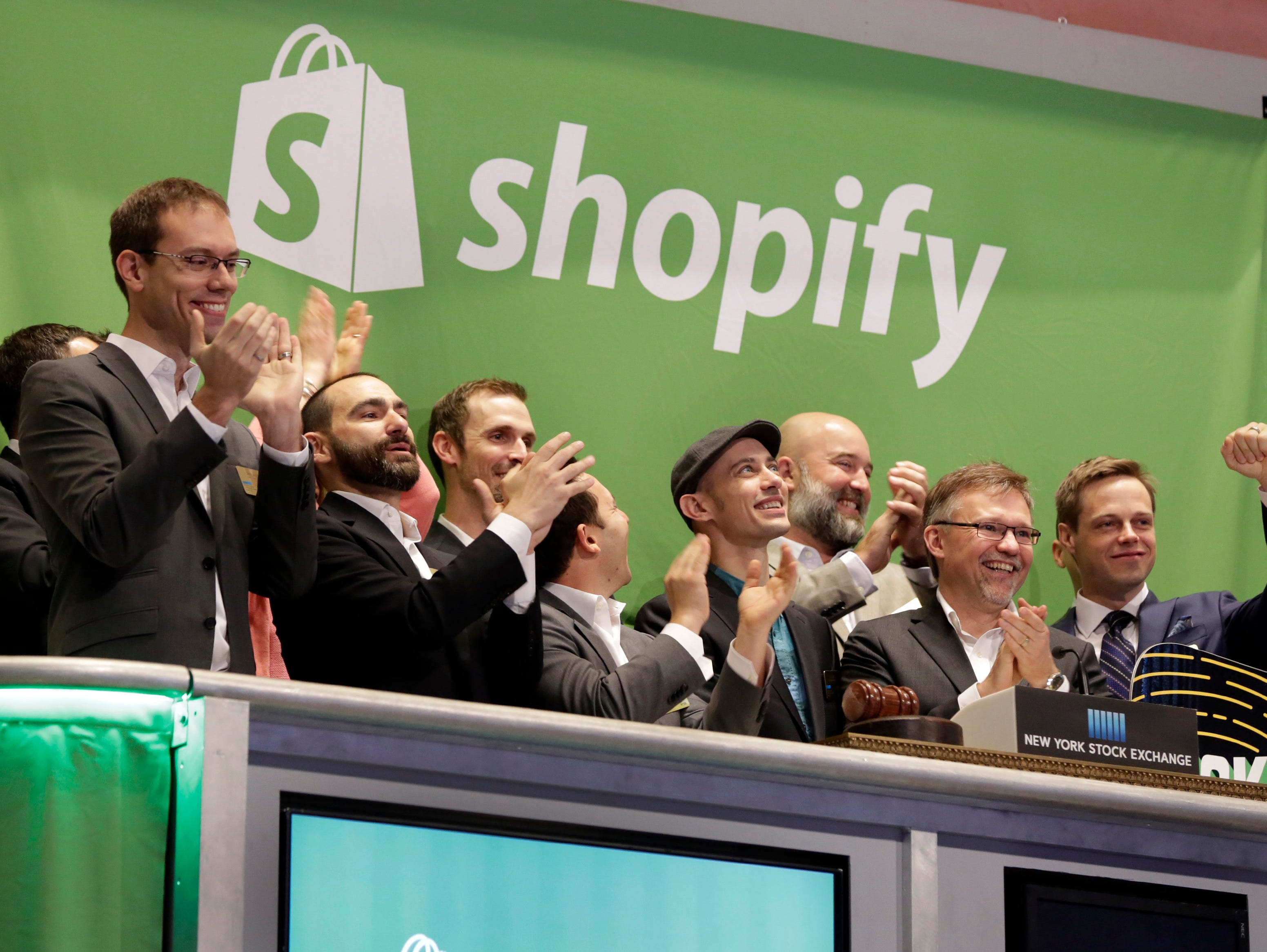 Shopify CEO Tobias Lutke, center wearing hat, is celebrated as he rings the New York Stock Exchange opening bell on Thursday.