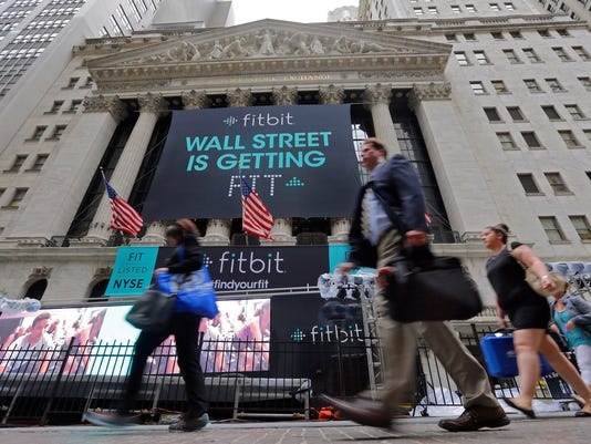Fitbit shares fall on earnings beat