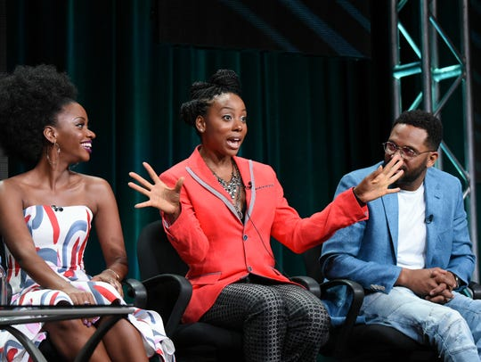 Actors Teyonah Parris, left, Erica Ash and Mike Epps