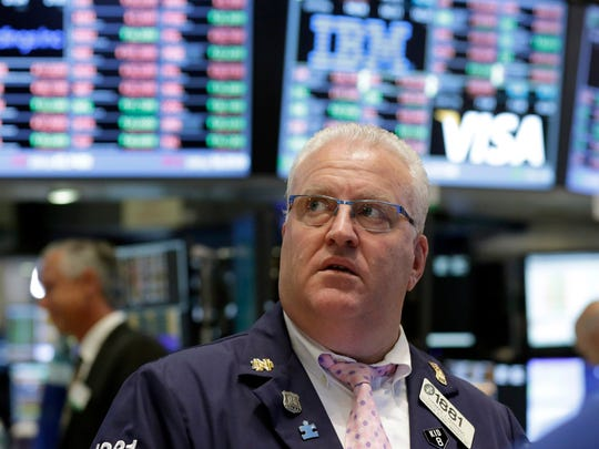 Trader Thomas Ferrigno works on the floor of the New York Stock Exchange Tuesday.