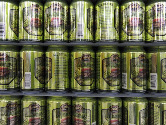 Cans of Founders Brewing's All Day IPA are displayed