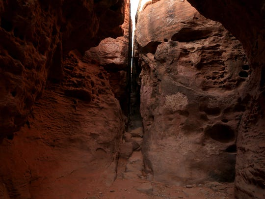 It doesn't cost anything to try and fit through the slot canyon at Pioneer Park on the Red Hill in St. George.