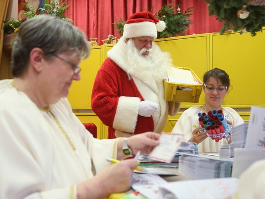 Santa Claus And His Angels Receive Christmas Mail