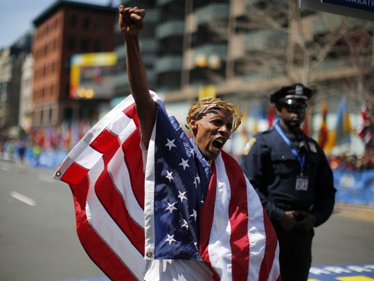 Meb Keflezighi of the U.S. reacts after winning the men's division of the 118th running of the Boston Marathon in Boston, Massachusetts April 21, 2014. He'll be running the Tallahassee Marathon on Sunday.