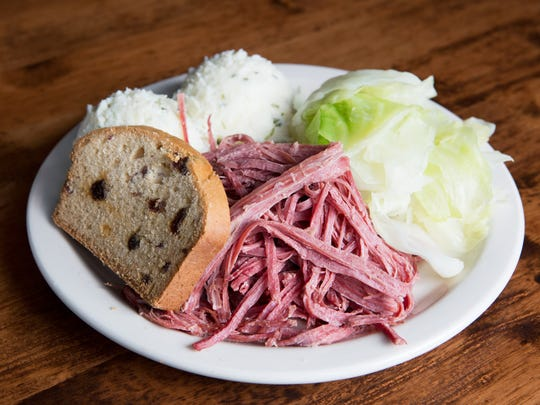 """Coach Bobby's Corned Beef and Cabbage from Nine Irish Brothers, 575 Massachusetts Ave. This dish is described as """"slow-cooked, melt-in-your-mouth corned beef."""" It comes in a half ($8.49) or full (shown here, $13.49) order and it's served with steamed cabbage and carrots, served over champ mashed potatoes."""