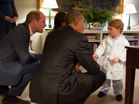 In his first royal meet-and-greet, the little prince, dressed in bathrobe and monogrammed slippers, got to stay up past bedtime to shake hands with President Barack Obama at Kensington Palace on April 22, 2016.