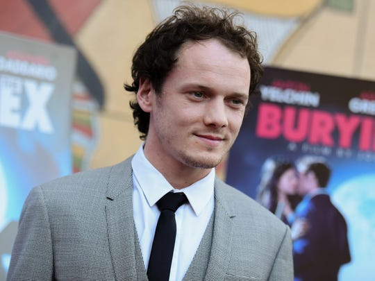 """In this June 11, 2015, file photo, Anton Yelchin arrives at a special screening of """"Burying the Ex"""" held at Grauman's Egyptian Theatre in Los Angeles. Yelchin, a charismatic and rising actor best known for playing Chekov in the new """"Star Trek"""" films, has died at the age of 27."""