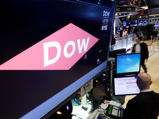 The company name of Dow appears above its trading post on the floor of the New York Stock Exchange on Dec. 9. The European Union's anti-trust watchdog is probing a planned merger between Dow and DuPont amid concern it could harm competition in the crop protection, seeds and petrochemicals sectors.