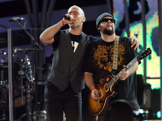 Ed Kowalczyk, left, and Chad Taylor from the band Live perform during the Nelson Mandela 46664 concert in Johannesburg, South Africa, Saturday, Dec. 1, 2007.