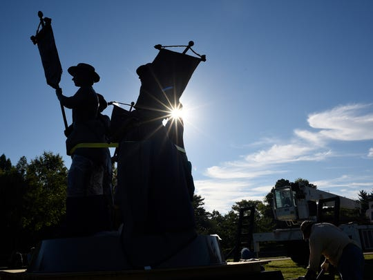 A monument to women's suffrage is briefly unveiled during its installation near the Parthenon in Centennial Park on Aug. 22, 2016. Two years in the making, LeQuire's sculpture depicts five women involved in Tennessee's ratification of the 19th Amendment, including Anne Dallas Dudley and Frankie Pierce of Nashville.