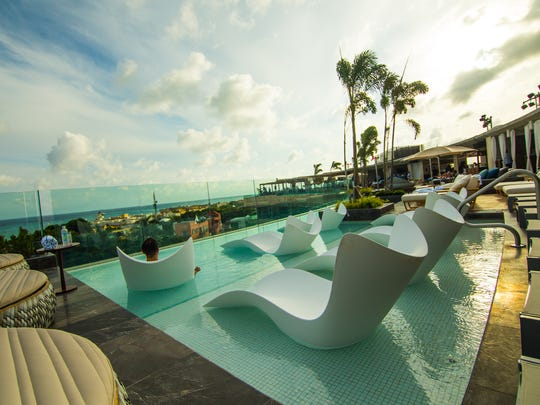 The rooftop lounge area at Thompson Playa del Carmen.