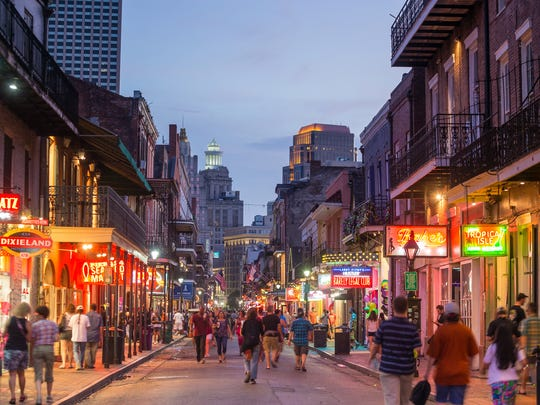 Neon lights illuminate the French Quarter in New Orleans.