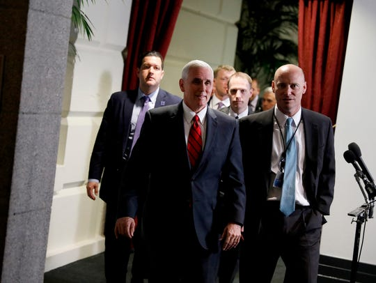 Vice President Pence departs after a meeting of House