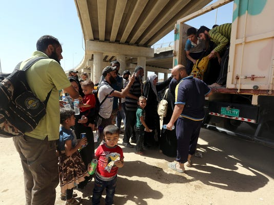 Iraqi families fear reprisals against relatives forced to help ISIS