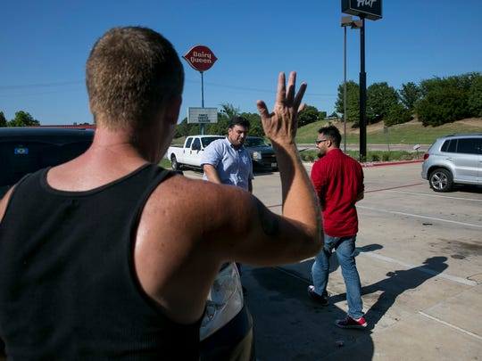 """David Wright waves goodbye to Ali Ghouri and Tameem Budri after the meeting. Wright surprised Ghouri by declaring he would not be protesting at mosques in the future. """"I cannot believe what I am hearing,"""" Ghouri said."""