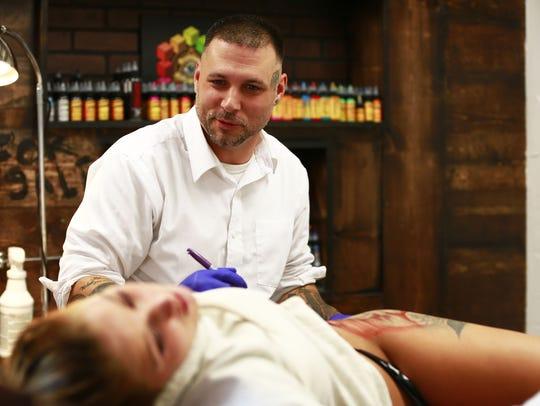 Tattoo artist Tommy Kirschbaum, owner of Mid-West Tattooers